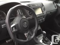 Make Volkswagen Model Tiguan Year 2013 Colour Grey kms