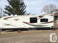 2013 Winnebago 30RE Trailer with two slide outs (living