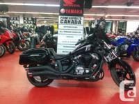 Extras include windshield, hard bags, grips, mirrors,
