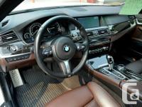 Make BMW Model Activehybrid 5 Year 2014 Colour White