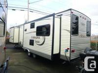 The 2014 Catalina 333RETS is a rear enjoyment travel