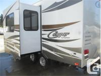 Price: $23,900 loaded small cougar travel trailer with