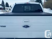 Make. Ford. Model. F-150. Year. 2014. Colour. White.