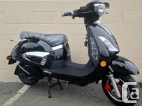 Black and chrome all electric scooter, comes with