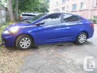 2014 Accent Sedan by Hyundai, Marathon Blue. -Bluetooth