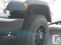 Make Jeep Model Wrangler Colour White Trans Manual kms