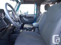 Trans Manual This 2014 Jeep Wrangler Sport comes with