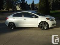 Make Kia Model Forte Year 2014 Colour Pearl White kms