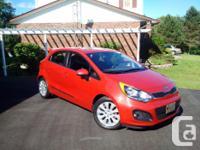 Make Kia Model Rio5 Year 2014 Colour Red Metallic kms