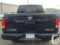 Make Nissan Model Titan Year 2014 Colour Black kms