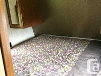 Springdale 28 foot travel trailer. Has a bedroom with a
