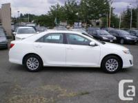 Make Toyota Model Camry Colour White Trans Automatic