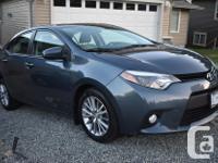 Make Toyota Model Corolla Year 2014 Colour Grey kms