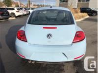 Make Volkswagen Model Beetle Year 2014 Colour Blue kms
