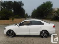 Make Volkswagen Model Jetta Year 2014 Colour White kms