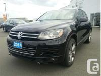 Make Volkswagen Model Touareg Year 2014 Colour Black