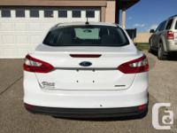 Make Ford Model Focus Colour White Trans Automatic kms