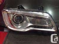 Used 2015-17 Chrysler 300 OEM halogen headlight set. No
