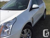 Make Cadillac Model SRX Year 2015 Colour White kms