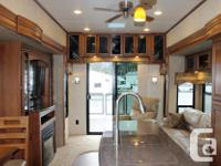 The triple slide Sandpiper 360PDEK 5th Wheel offers