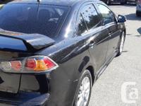 Make Mitsubishi Model Lancer Year 2015 Colour Black