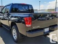 Make Nissan Model Titan Year 2015 Colour Black kms