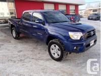 Make Toyota Model Tacoma Year 2015 Colour Blue kms