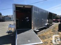 - 4 place enclosed drive through snowmobile trailer -