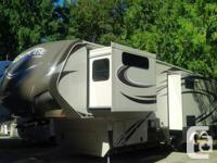 This incredibly beautiful, lightly used 5th wheel, with