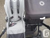 One original seat and canopy (black) grey melange seat