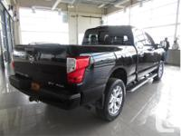 Make Nissan Model Titan Year 2017 Colour Black kms