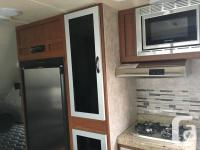 The Travel Lite Falcon F-21RB is a travel trailer that