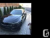 Make BMW Model M4 Year 2018 Colour Black kms 16000