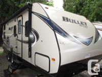 The Bullet 243 BHS Travel Trailer is sleek and smooth