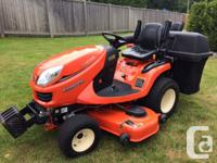 2018 Kubota GR2120 4WD Tractor with bagger, arm rests