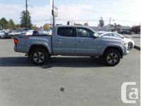 Make Toyota Model Tacoma Year 2018 Colour Grey kms