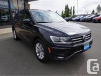 Make Volkswagen Model Tiguan Year 2018 Colour Black