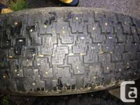 4 Bridgestone studded winter tires 205/70 R14, mounted