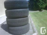 set of 4 of excellent tires only NO RIMS , Blizzak WS70
