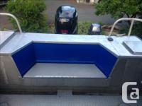 Self bailing deck, lots of storage, porta potty,