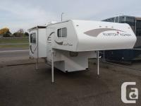 Don't miss out on this LOADED truck camper! This unit