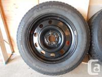 4 Michelin X-ICE winter season tires installed on rims