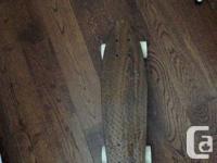 22 inch Globe Skateboard with a brown(woodlike) skin.