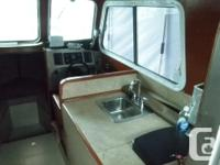 Custom built boat with 205 hp Mercruiser engine with