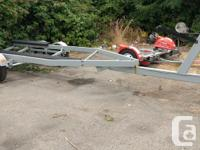 23 ft 1999 Ubuilt tandem boat trailer with new brakes