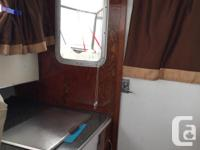 1983 Hourston sedan. This boat has been rebuilt from