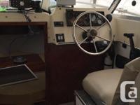 1983 23 ft Hurston sedan. This boat has been rebuilt