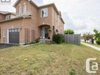 Overview Well Maintained End Unit (Corner Lot) In A