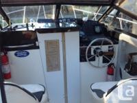 23' Trophy perambulate with a 2002 Evinrude 225