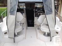 23' Trophy walk around with a 2002 Evinrude 225